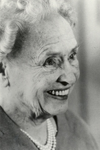 Helen Keller, beaming, at 80 years old
