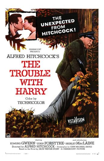 Movie poster for The Trouble With Harry - in the upper left corner a man and woman kiss, while in the foreground an older man drags a business-suit-clad body through the autumn leaves