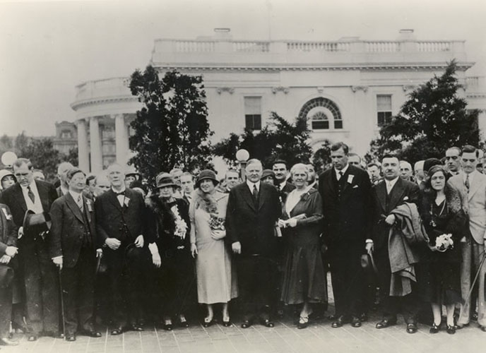 Helen Keller, President Herbert Hoover, and international delegates outside the White House, 1932