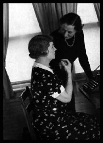 Helen at the typewriter, Polly Thomson standing beside her, 1933