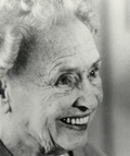 Helen Keller as an older woman, smiling widely