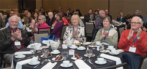 AFB Leadership Conference attendees seated around a table during one of the awards ceremonies at the conference.