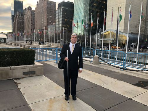 Kirk Adams standing out front of the United Nations Building.
