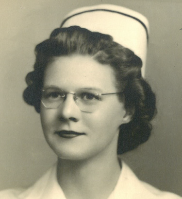 Black and white photo of Ruth Stank. She is in her mid-20s to -30s and is wearing glasses. She dressed in a nurse uniform, complete with paper hat.