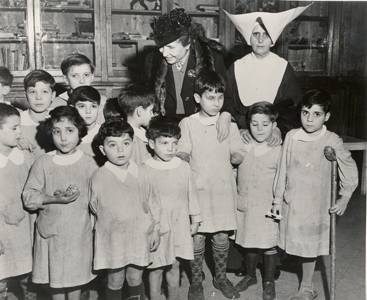 Helen visiting disabled, deaf, and blind children in post-war Rome, Italy, 1946