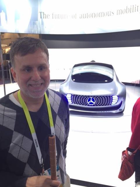 Paul Schroeder stands in front of the Mercedes self-driving concept car at the 2015 Consumer Electronics Show