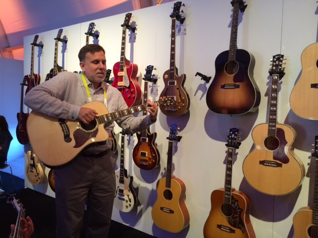 Paul Schroeder playing guitar at the Gibson booth