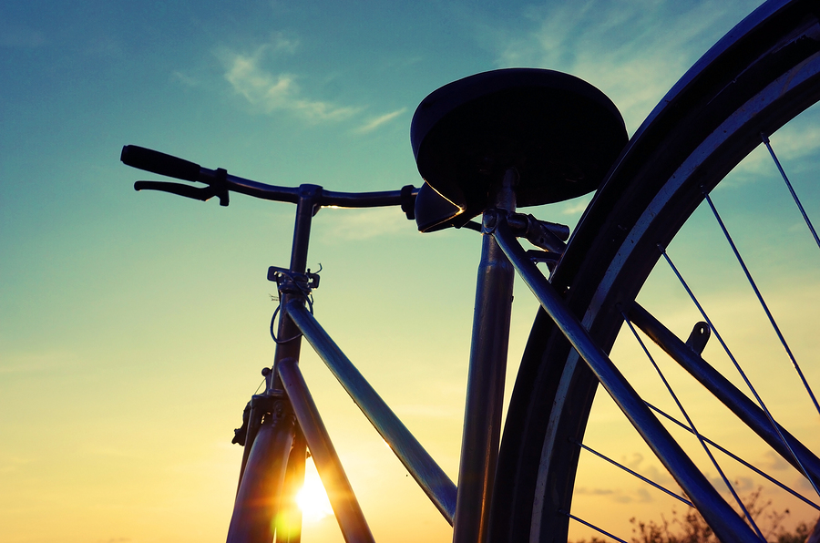 silhouette of a bicycle against a sunset
