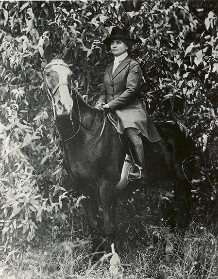 Helen Keller on horseback