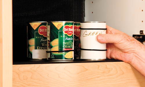 Cans of food with rubber bands placed around at certain spots for accessible identification