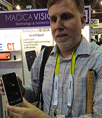 Paul Schroeder at the MagicaVision booth, trying their Android phone
