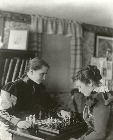Helen and Anne playing chess, 1900