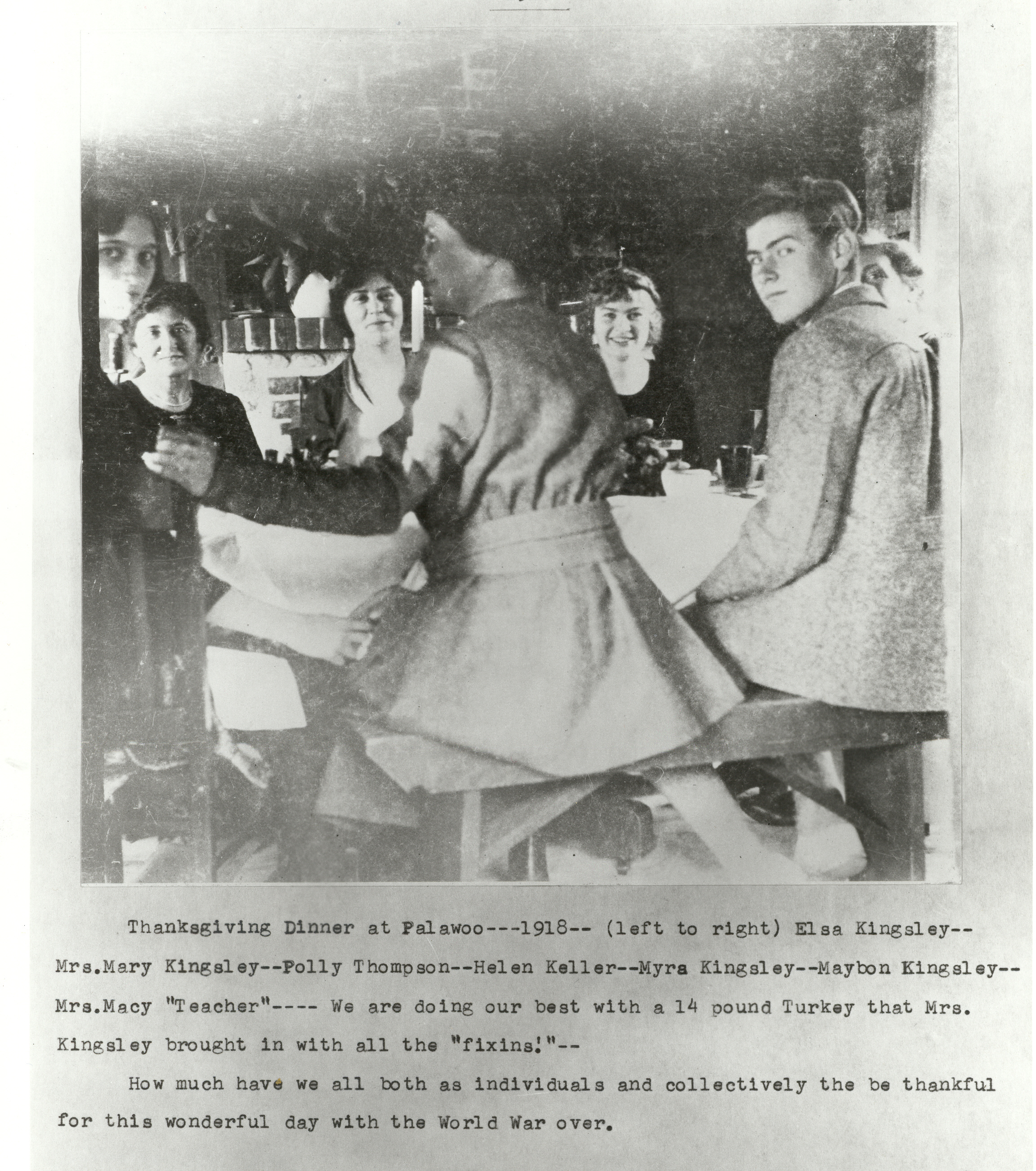a photo of Helen Keller with friends celebrating Thanksgiving Dinner
