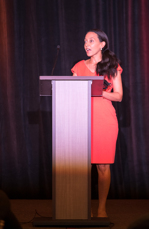 Haben Girma speaking at the podium during the 2018 HKAA.