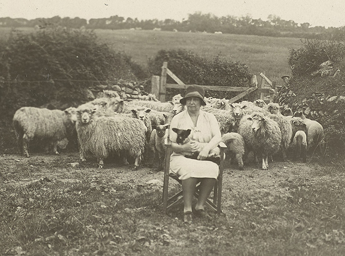 Helen Keller with sheep in Scotland.