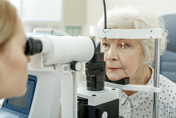 older woman at an eye exam