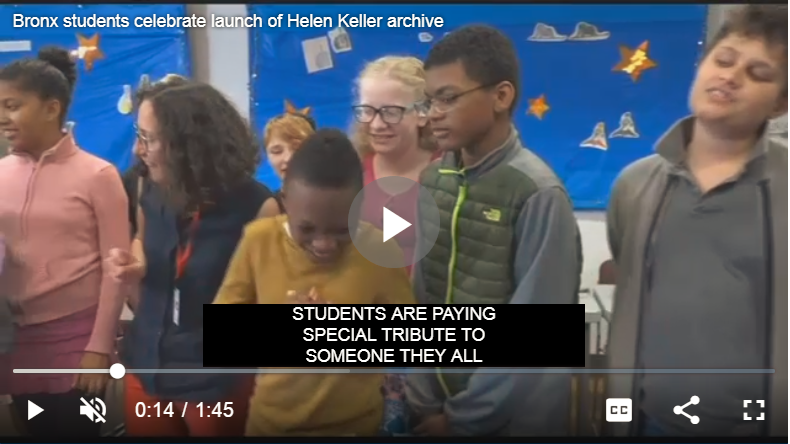 Video still of students at the New York Institute of Special Education singing happy birthday to Helen Keller.