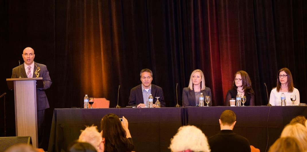 Russell Shaffer speaks while Jennison Asuncion, LinkedIn; Megan Mauney, Florida Blue; Jen Guadagno, Microsoft; and Dina Grilo, JPMorgan Chase & Co., look on.