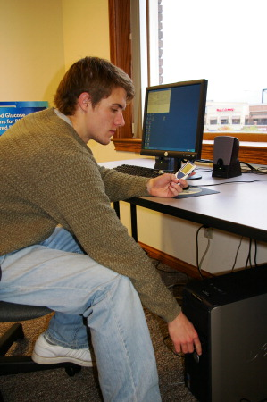 An AFB TECH intern transfering data from the SensoCard to a PC.