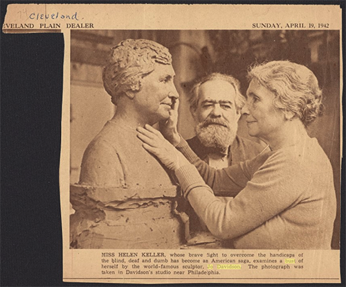 CLEVELAND PLAIN DEALER  SUNDAY, APRIL 19, 1942  MISS HELEN KELLER, whose brave fight to overcome the handicaps of the blind, deaf and dumb has become an American saga, examines a bust of herself by the world-famous sculptor, Jo Davidson. The photograph was taken in Davidson's studio near Philadelphia.