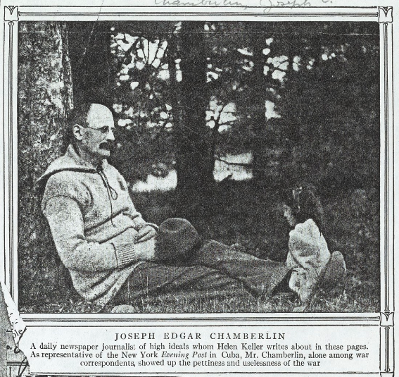 Newspaper clipping of Joseph Edgar Chamberlin, sitting relaxed under a tree. A young girl sits at his feet.