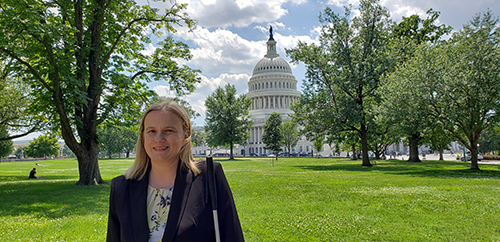 Stacy Cervenka, Director Public Policy. In the background the US Capitol Building can be seen