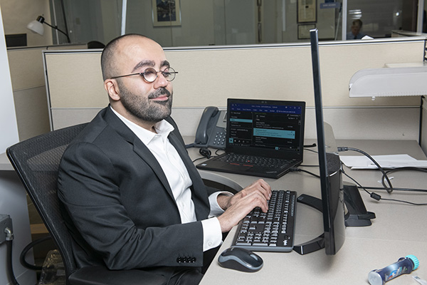 Amir Rahimi at his desk, typing
