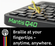 Praying mantis sitting atop the keyboard of the Mantis™ Q40 refreshable braille display.