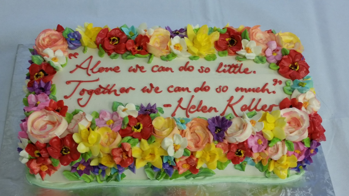 Cake covered in flowers and a quotation celebrating Helen Keller's birthday