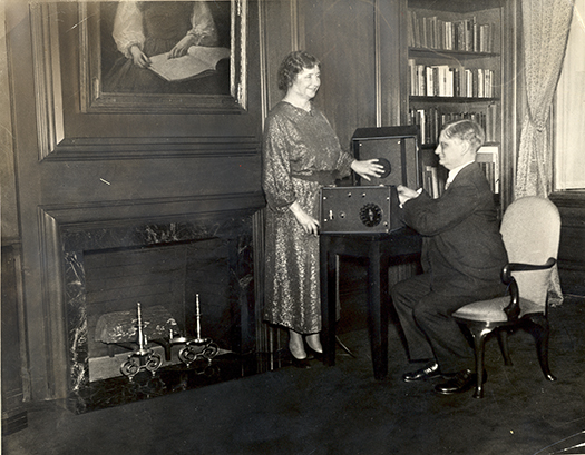 Helen Keller and Robert Irwin: Helen is touching a phonograph and smiling