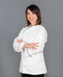 Christina Ha standing with arms folded wearing a white chef's tunic and black pants; Courtesy of Julie Soefer Photography.