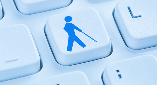 computer keyboard with one key depicting an icon of a person who is blind, walking with a long cane