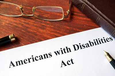 americans with disability act on table with pen